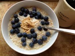 Steel cut oatmeal, with blueberries, and a bit of peanut butter